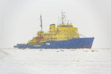 Icebreaker in the port Sabetta. Russia, Yamal, Kara Sea. Winter, snowfall