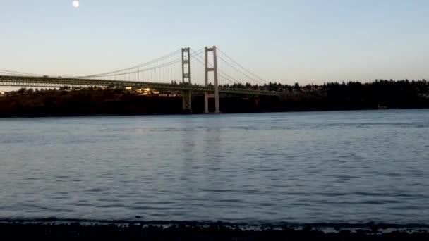 moon rising over tacoma narrows bridge in spring