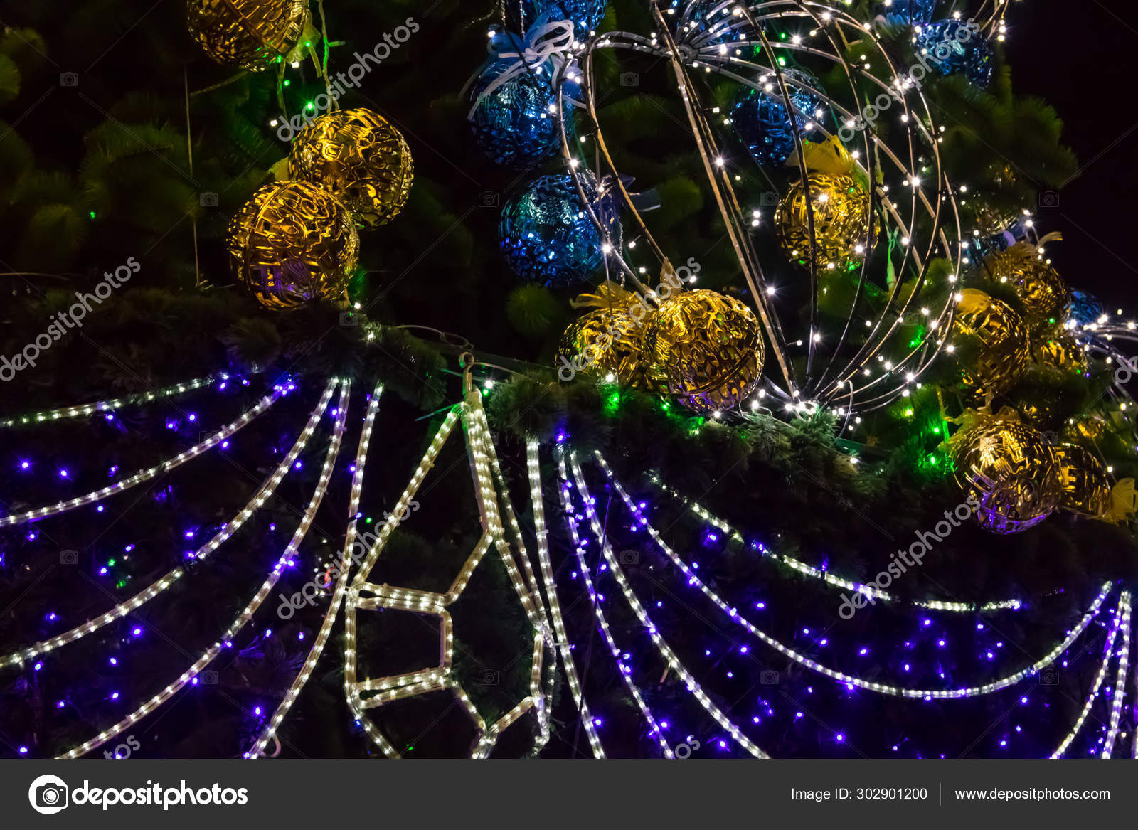Decorated Christmas Tree With Multi Colored Lights At Night Stock Photo C Olyasolodenko 302901200