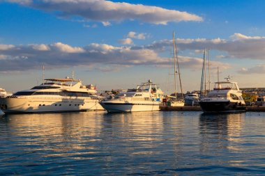 White yachts in the sea harbor of Hurghada, Egypt. Port with tourist boats on the Red Sea