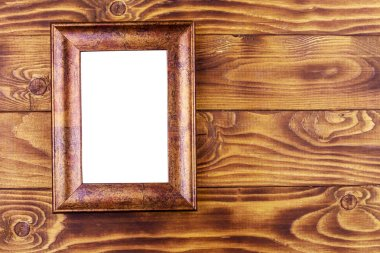 Empty photo frame on wooden background. Top view
