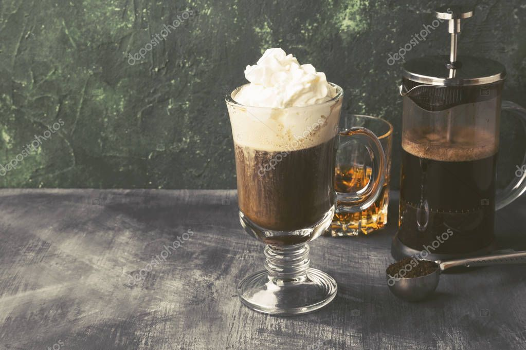 Irish coffee with whisky on dark background. Copy space. Food ba
