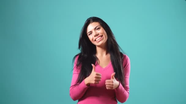 Portrait of happy woman showing sign meaning approval