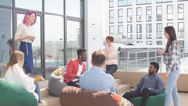 People discussing working process while sitting at the office lounge outdoor