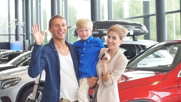 Happy family near new car. Auto dealership centre