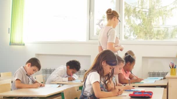 female teacher teaching group of teenagers in high school lesson