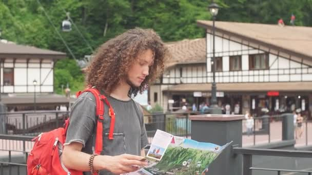 tourist with route maps looking for a way in city. search landmarks