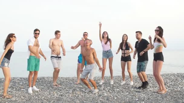 Best Friends dancing at beach on sunny day