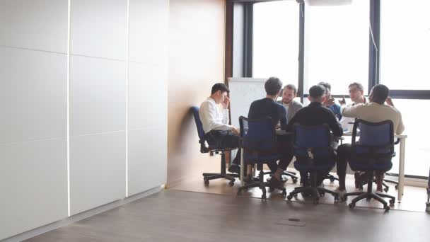 Business men in an open space office interior with a panoramic window