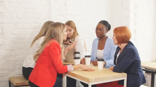 Team work process. Multiracial group of women coloborating in open space office.
