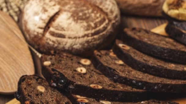 Whole grain multigrain bread, whole and sliced, contains seeds isolated on black