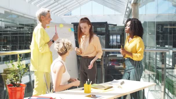 hardworking diverse stylish businesswomen concentrated on work