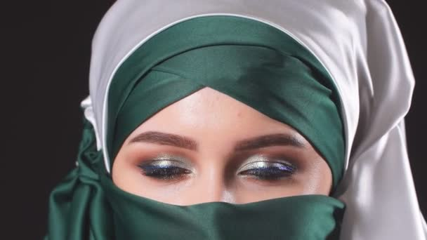 Portrait of an attractive young modern Muslim woman in hijab.