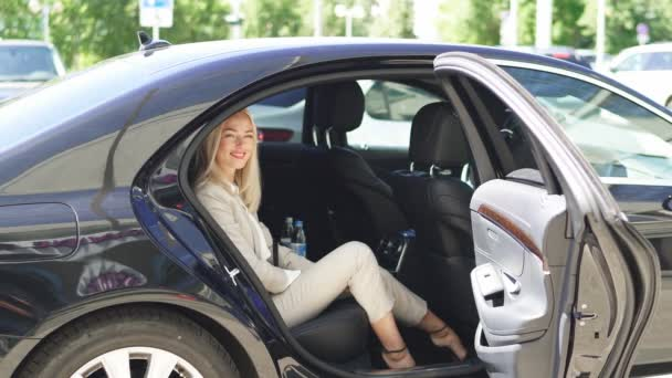 Confident business woman inside of car