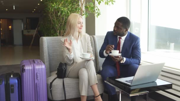 business people spend time over cup of coffee in airport.