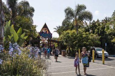 CHULA VISTA, CALIFORNIA/USA - JUNE 20, 2018:  People exit Aquatica, a water park with thrill rides, aquariums, dolphins and penguins.