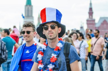 MOSCOW, RUSSIA - June 29, 2018: The 2018 FIFA World Cup. French fan in the original hat on Red square