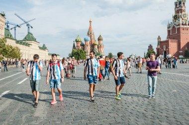 MOSCOW, RUSSIA - June 29, 2018: The 2018 FIFA World Cup. Argentine fans in striped white-blue t-shirts in colors of the flag of Argentina go on Red square