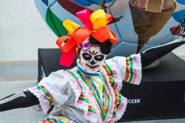 MOSCOW, RUSSIA - June 29, 2018: The 2018 FIFA World Cup. A National house for Mexican fans in Gostiny Dvor. Celebration of the Day of the Dead. Woman dressed as the goddess of death performs a dance