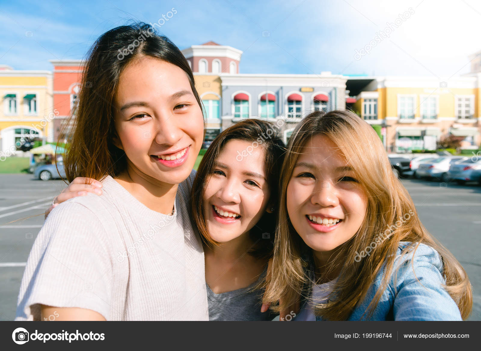 9a2afbdb52d Close up of young Asian women group selfie themselves in the pastel  buildings city in nice sky morning. City lifestyle of young women group on  weekend.