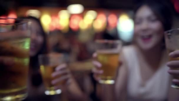 Traveler backpacker Asian women lesbian lgbt couple travel in Bangkok, Thailand. Female drinking alcohol or beer with friends and having party at The Khao San Road.