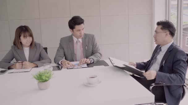 Slow motion - Businessman meeting in workplace with his colleague and signing a contract. Chief checking and reading work documents and be serious.