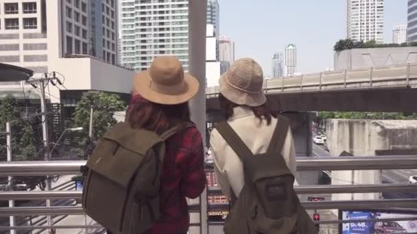 Traveler backpacker Asian women lesbian lgbt couple travel in Bangkok, Thailand. Happy young female spending holiday trip at amazing landmark and enjoy her journey in traditional city.