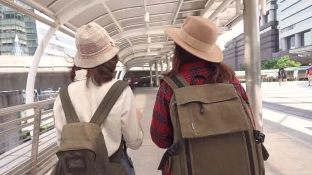 Slow motion - Traveler backpacker Asian women lesbian lgbt couple travel in Bangkok, Thailand. Happy young female spending holiday trip at amazing landmark and enjoy her journey in traditional city.