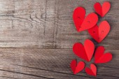 valentines day paper hearts on old wooden background