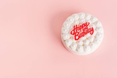 Happy colorful birthday cake on pink background
