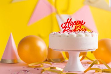 Happy colorful birthday party background with birthday cake and party accessorizes
