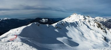 Panoramic view of Aibga mountain ridge (Northern slope) in Rosa Khutor alpine resort. Sochi, Russia. Nature background