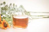 Autumn tea. Marigolds and tea cup autumn background