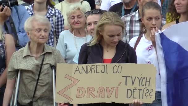 OLOMOUC, CZECH REPUBLIC, MAY 15 , 2018: Demonstration of people crowd against the Prime Minister Andrej Babis and president Milos Zeman, a banner with Andrej, whats your kids health, young woman