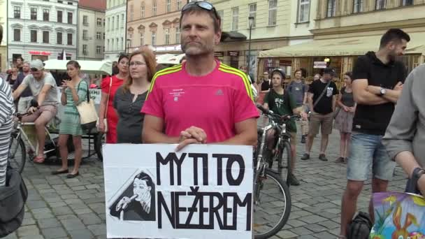 OLOMOUC, CZECH REPUBLIC, MAY 15 , 2018: Demonstration of people crowd against the Prime Minister Andrej Babis and president Milos Zeman, a banner with were not gonna eat you