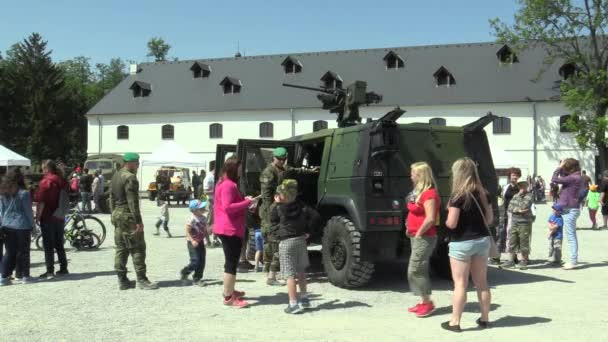 OLOMOUC, CZECH REPUBLIC, MAY 5, 2018: Lightweight armored vehicle Iveco LMV with 12.7 mm machine gun M2 M151 firepower with high firepower, families with children and people, day of the Army