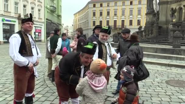OLOMOUC, CZECH REPUBLIC, APRIL 1, 2018: Men and woman in the traditional folk costume of Hana at the great Easter celebrations holidays children with whip, Paschal people colorfully decorated lace