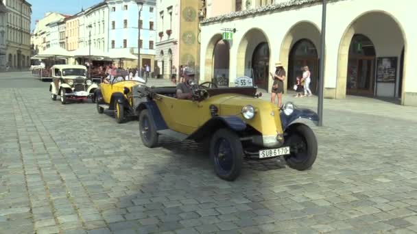 OLOMOUC, CZECH REPUBLIC, JULY 5, 2018: Historic cars veterans on a public car ride through city of Olomouc drive people, first arriving of Tatra 11 1923, Zbrojovka Brno Z 18 valnik and Walter Junior