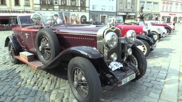 OLOMOUC, CZECH REPUBLIC, JULY 5, 2018: Historic cars veterans on a public car ride through city of Olomouc drive people, first arriving Bugatti 57 1934