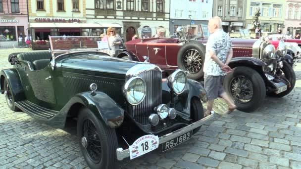 OLOMOUC, CZECH REPUBLIC, JULY 5, 2018: Historic cars veterans on a public car ride through city of Olomouc drive people, first arriving of Bentley Tourer 1938, and Bugatti 57 1934