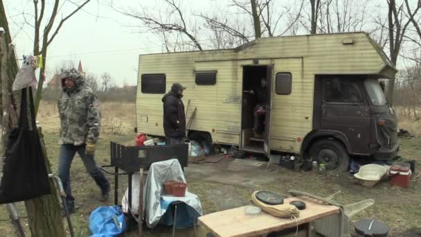 BRNO, CZECH REPUBLIC, MARCH 24, 2018: Homeless go to the place where other homeless poor people live with an old unused caravan car, life on the brink of survival, the civilization global problem