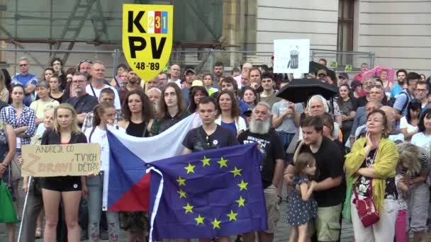 OLOMOUC, CZECH REPUBLIC, MAY 15 , 2018: Demonstration of people crowd against the Prime Minister Andrej Babis and president Milos Zeman, a banner with conference of political prisoners, flag