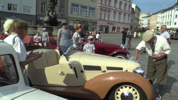OLOMOUC, CZECH REPUBLIC, JULY 5, 2018: Historic car veteran on a public car ride through city of Olomouc drive people, Aero 30 1939, the old man polishes the car and people admire him