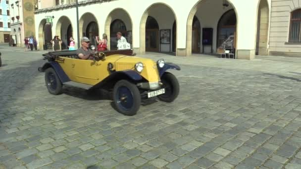 OLOMOUC, CZECH REPUBLIC, JULY 5, 2018: Historic cars veterans on a public car ride through city of Olomouc drive people, first arriving of Tatra 11 1923 and Zbrojovka Brno Z 18 valnik