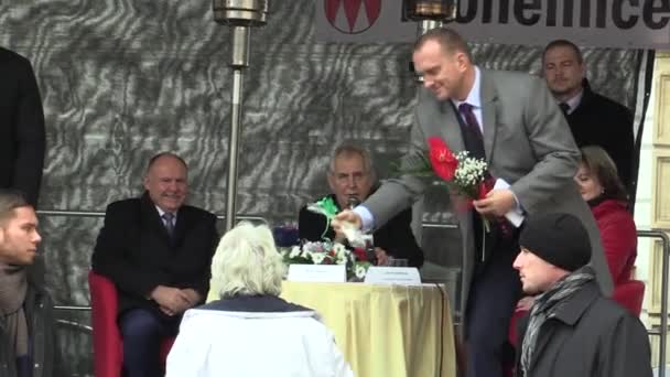MOHELNICE, CZECH REPUBLIC, NOVEMBER 9, 2017: President of the Czech Republic Milos Zeman visiting Mohelnice, senior woman gives the president a flower and a gift, emotional situation