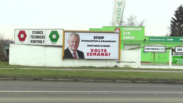 OLOMOUC, CZECH REPUBLIC, JANUARY 18, 2018: Billboard in support of the candidacy of Milos Zeman in direct election to the President of the Czech Republic, inscription: Stop Immigrants, road cars