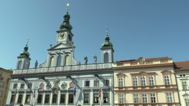 CESKE BUDEJOVICE, CZECH REPUBLIC, SEPTEMBER 2, 2018: Town and city hall building with the seat of the municipality, baroque architecture with flags, city of main square Premysla Otakara II