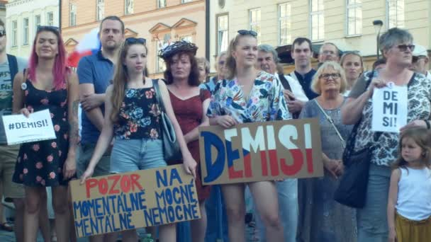 PRAGUE, CZECH REPUBLIC, JUNE 11, 2019: Demonstration of people crowd against Prime Minister Andrej Babis, banner with demission and resignation and second for the currently ill and mentally ill,