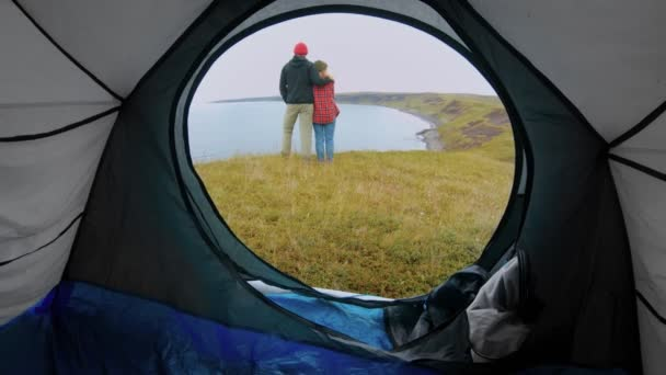 Adventure camping couple on cliff with tent