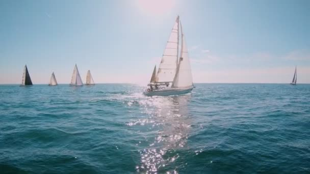 Beautiful graceful sailboat yacht at open sea